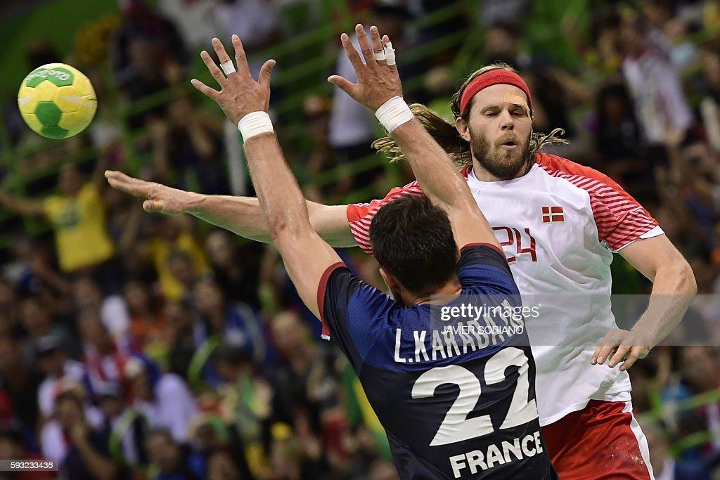 TOPSHOT Denmark's left back Mikkel Hansen passes the ball past France's pivot Luka Karabatic during the men's Gold Medal handball match Denmark vs...