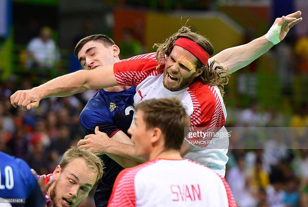 TOPSHOT Denmark's left back Mikkel Hansen throws the ball past France's pivot Ludovic Fabregas during the men's Gold Medal handball match Denmark vs...