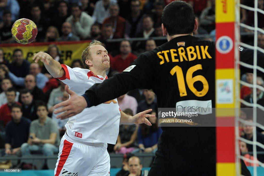 Denmark's left wing Anders Eggert (L) shoots at Spain's goalkeeper Arpad Sterbik during the 23rd Men's Handball World Championships final match Spain vs Denmark at the Palau Sant Jordi in Barcelona on January 27, 2013.
