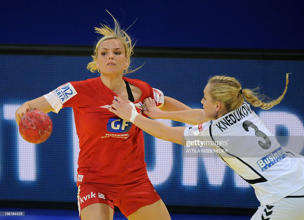 Denmark's leftback Pernille Larsen (L) is fouled by Czech Republic's Jana Knedlikova (R) during the the 2012 EHF European Women's Handball Championship Group II match on December 10 , 2012, at the Kombank Arena in Belgrade. Denmark won 33-30.
