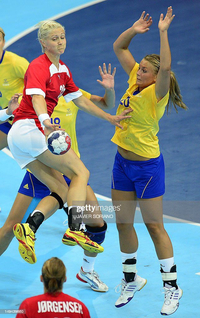 Denmark's leftback Rikke Skov (L) vies with Sweden's centreback Isabelle Gullden during the women's preliminaries Group B handball match Denmark vs Sweden for the London 2012 Olympics Games on July 28, 2012 at the Copper Box hall in London.