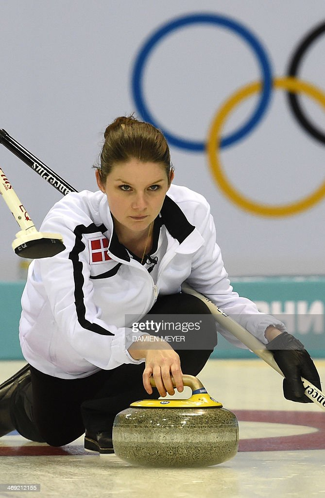 Denmark's Lene Nielsen throws the stone during the Women's Curling Round Robin Session 6 against Sweden at the Ice Cube Curling Center during the...