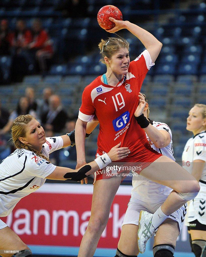Denmark's Line Jorgensen (C) vies with Czech's Pavla Poznarova (L) and Petra Vitkova during their Women's EHF Euro 2012 Handball Championship match Czech Republic vs Denmark on December 10, 2012, at the Belgrade Arena.