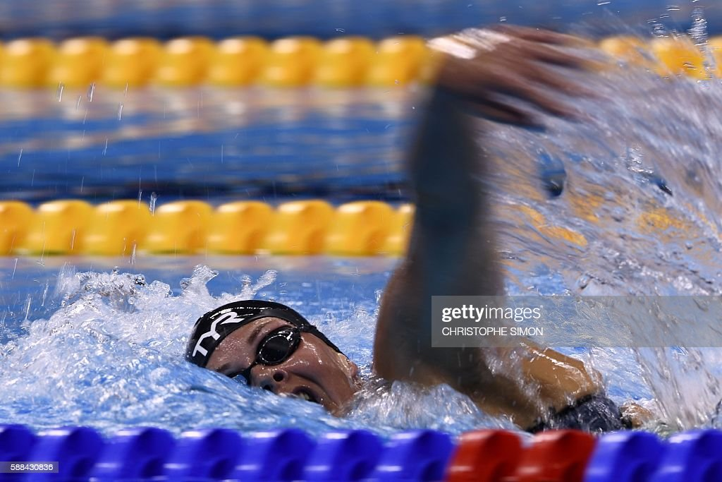 Denmark's Lotte Friis competes in a Women's 800m Freestyle heat during the swimming event at the Rio 2016 Olympic Games at the Olympic Aquatics...