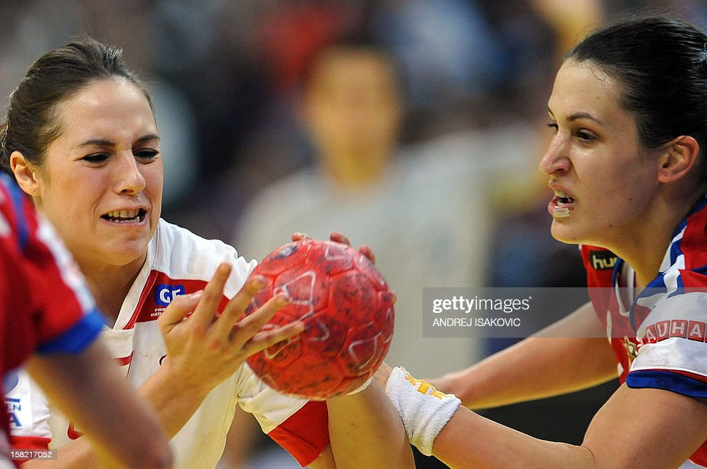 Denmark's Louise Burgaard (C) vies with Serbia's Andrea Lekic (R) during their Women's EHF Euro 2012 Handball Championship match Serbia vs Denmark on December 11, 2012, at the Belgrade Arena.