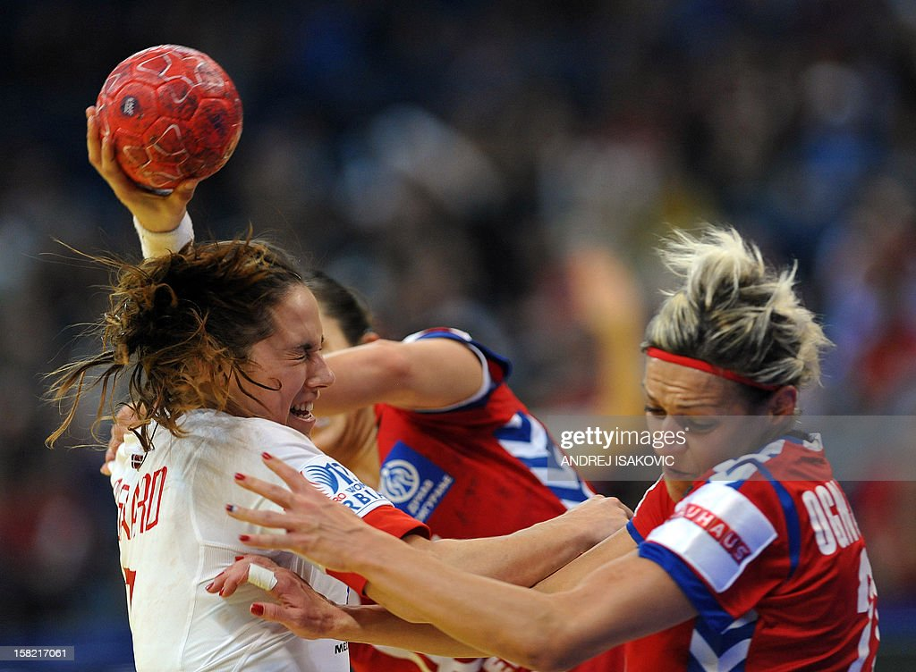 Denmark's Louise Burgaard (L) vies with Serbia's Svetlana Ognjenovicduring their Women's EHF Euro 2012 Handball Championship match Serbia vs Denmark on December 11, 2012, at the Belgrade Arena.