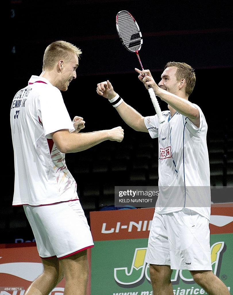 Denmark's Mads Conrad-Petersen (R) and Mads Pieler Kolding celebrate during their men's double match against Russia's Vladimir Ivanov and Ivan Sozonov (not pictured) at the 2014 BWF Badminton World championships held at the Ballerup Super Arena in Copenhagen on August 25, 2014. Denmark's team won the match.