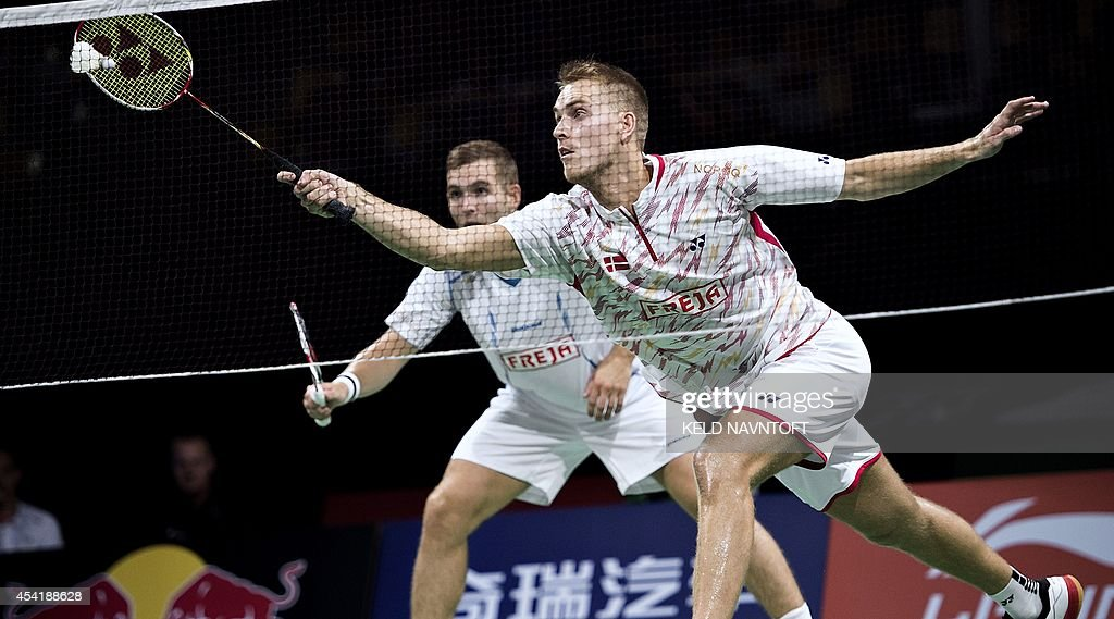 Denmark's Mads Conrad-Petersen (R) and Mads Pieler Kolding play against Russia's Vladimir Ivanov and Ivan Sozonov (not pictured) during their men's double match at the 2014 BWF Badminton World championships held at the Ballerup Super Arena in Copenhagen on August 25, 2014.
