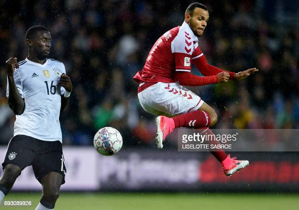 Denmark's Martin Braithwaite and Germany's Antonio Rüdiger vie for the ball during the friendly football match between Denmark and Germany in Brondby...