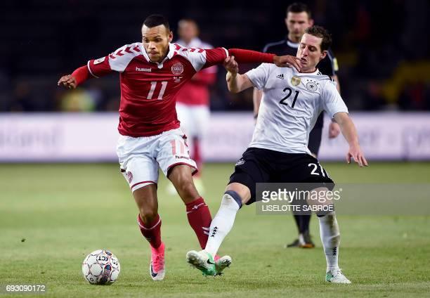 Denmark's Martin Braithwaite and Germany's Sebastian Rudy vie for the ball during the friendly football match between Denmark and Germany in Brondby...