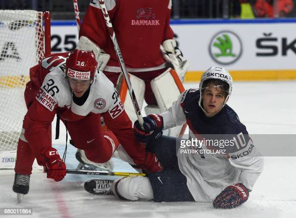 Denmark´s Matias Lassen and US Anders Bjork vie for the puck during IIHF Ice hockey world championship first round match between USA and Denmark in...