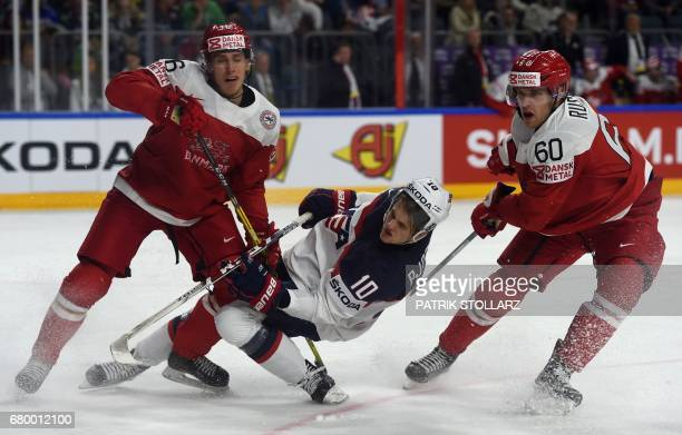 Denmark´s Matias Lassen Patrick Russell and US Anders Bjork vie for the puck during IIHF Ice hockey world championship first round match between USA...