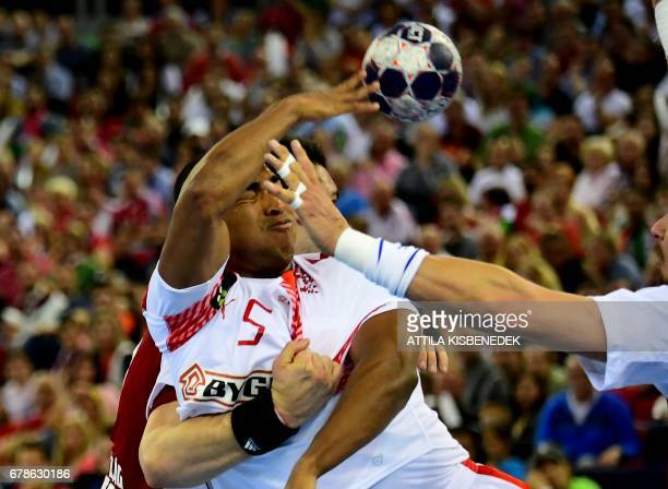 Denmark's Mensah Larsen fights for the ball with Hungary's Adam Juhasz during an EHF 2018 Men's European Championship qualification handball match...
