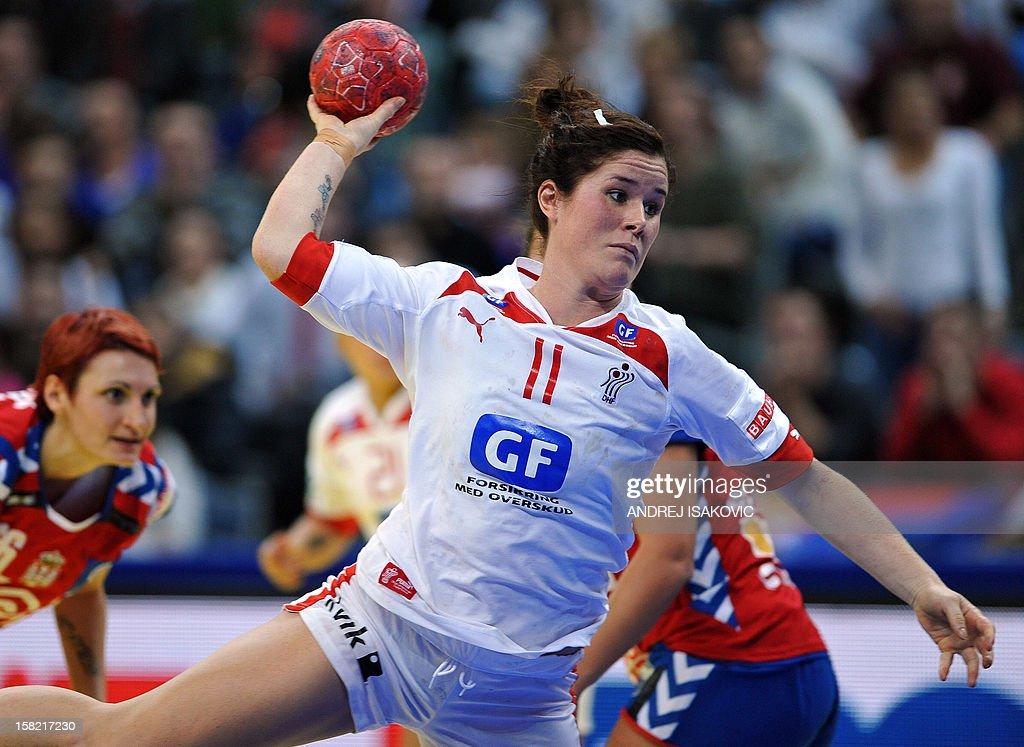 Denmark's Mette Gravholt shoots the ball against Serbia during their Women's EHF Euro 2012 Handball Championship match Serbia vs Denmark on December 11, 2012, at the Belgrade Arena.