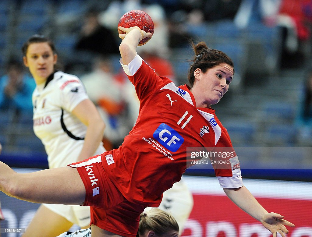 Denmark's Mette Gravholt shoots the ball during the Women's EHF Euro 2012 Handball Championship match Czech Republic vs Denmark on December 10, 2012, at the Belgrade Arena. AFP PHOTO / ANDREJ ISAKOVIC