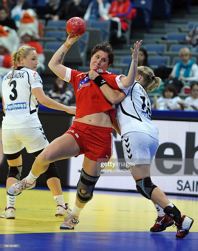 Denmark's Mette Gravholt (C) vies with Czech's Michaela Hrbakova (R) during their Women's EHF Euro 2012 Handball Championship match Czech Republic vs Denmark on December 10, 2012, at the Belgrade Arena.