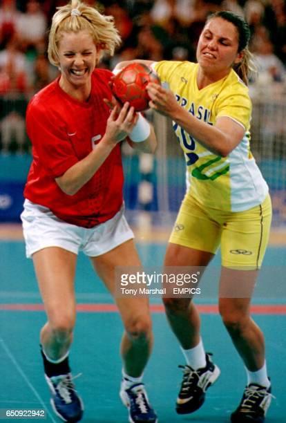 Denmark's Mette Vestergaard and Brazil's Viviani Emerick battle for the ball