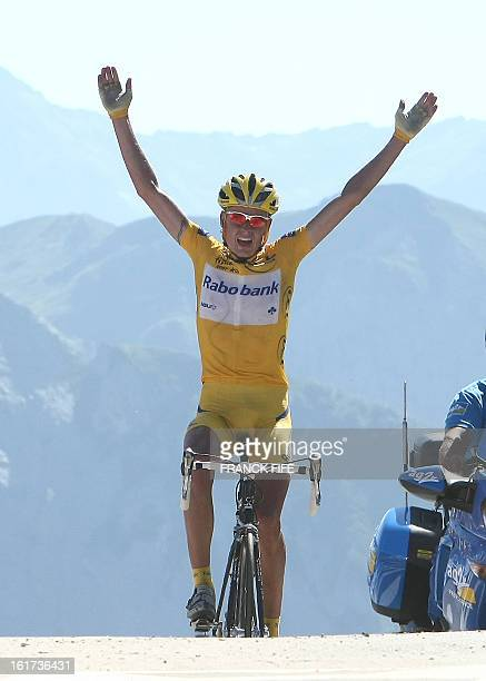 Denmark's Michael Rasmussen celebrates as he crosses the finish line of the 16th stage of the 94th Tour de France cycling race between Orthez and...
