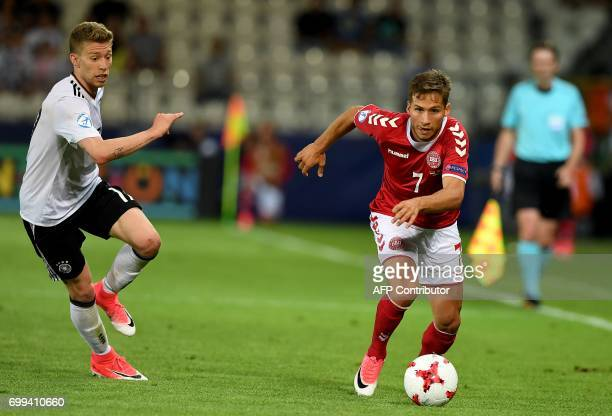 Denmark's midfielder Andrew Hjulsager and Germany's midfielder Mitchell Weiser vie for the ball during the UEFA U21 European Championship Group C...
