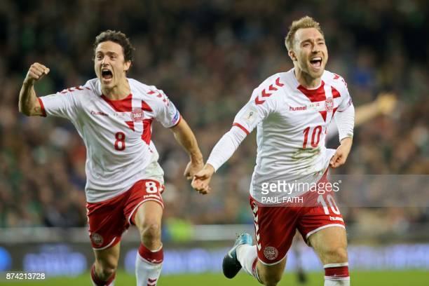 Denmark's midfielder Christian Eriksen celebrates with Denmark's midfielder Thomas Delaney after scoring their third goal during the FIFA World Cup...