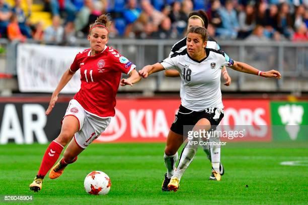 Denmark's midfielder Katrine Veje vies for the ball with Austria's midfielder Laura Feiersinger during the UEFA Womens Euro 2017 football tournament...