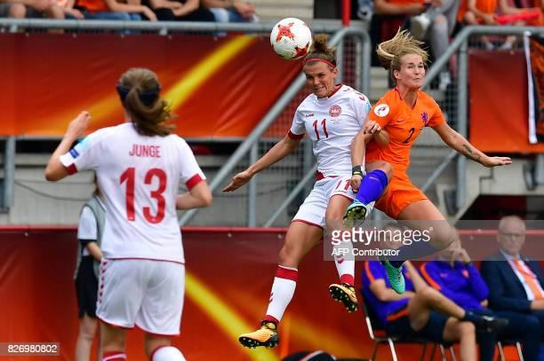 Denmark's midfielder Katrine Veje vies for the ball with Netherlands' defender Desiree van Lunteren during the UEFA Womens Euro 2017 football...