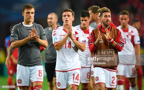 Denmark's midfielder Lasse Vigen Christensen Denmark's midfielder Casper Nielsen and Denmark's defender Frederik Holst applaud after the UEFA U21...