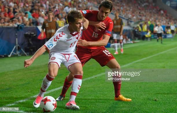 Denmark's midfielder Mathias Jensen and Czech Republic's defender Milan Havel vie for the ball during the UEFA U21 European Championship Group C...