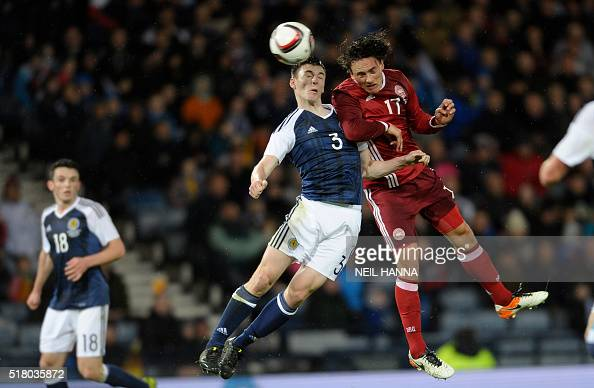 Denmark's midfielder Thomas Delaney and Scotland's defender Kieran Tierney go up for a high ball during the international friendly football match...