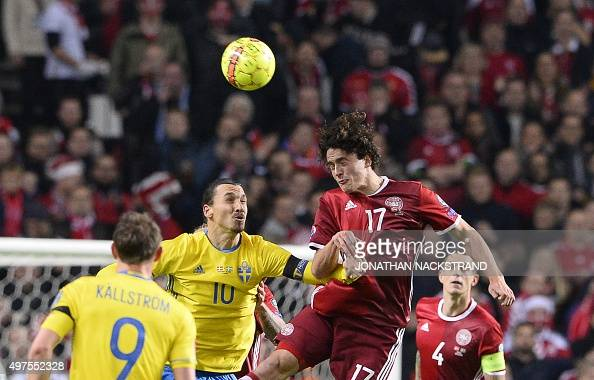 Denmark's midfielder Thomas Delaney and Sweden's forward and team captain Zlatan Ibrahimovic jump for a header during the Euro 2016 second leg...