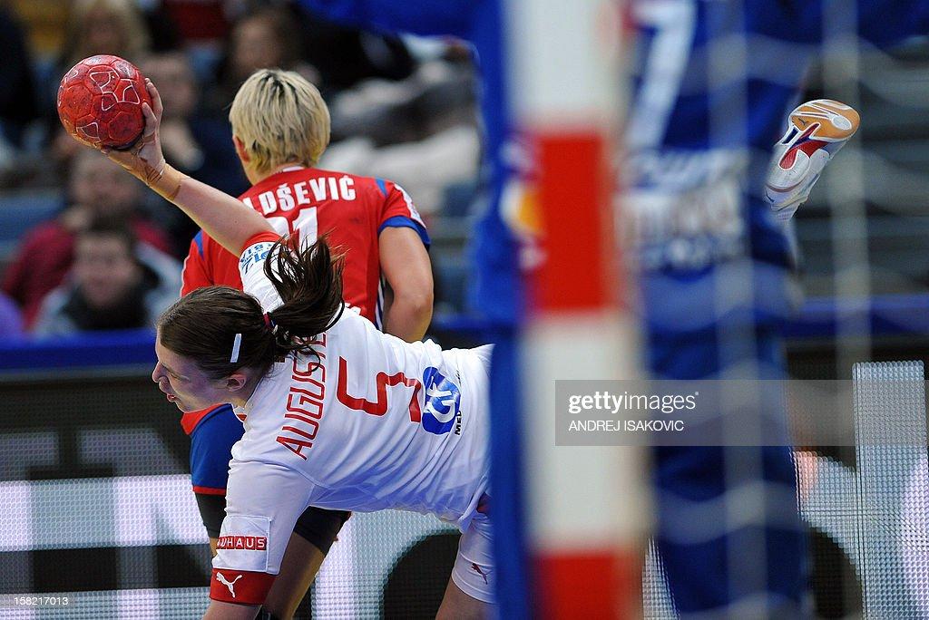 Denmark's Mie Augustsen (C, down) vies with Serbia's Ivana Milosevic during their Women's EHF Euro 2012 Handball Championship match Serbia vs Denmark on December 11, 2012, at the Belgrade Arena.