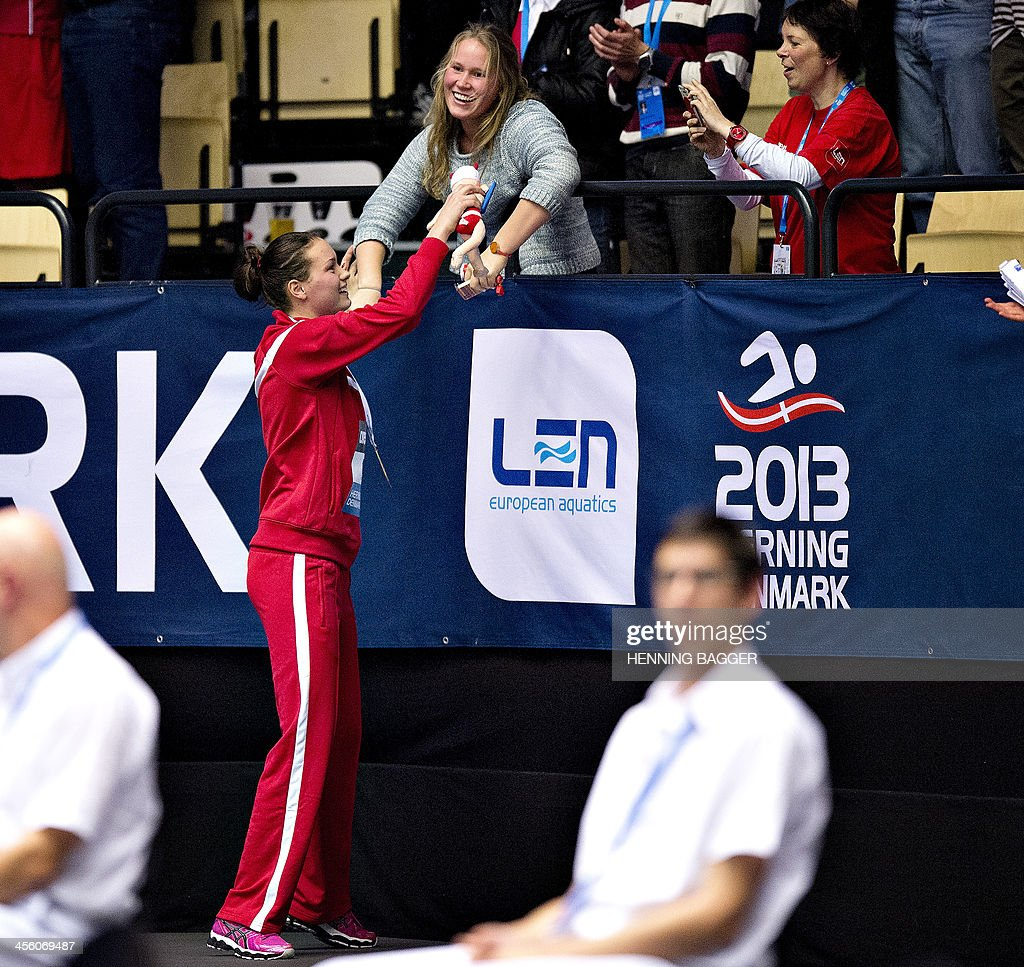 Denmark's <a gi-track='captionPersonalityLinkClicked' href=/galleries/search?phrase=Mie+Nielsen&family=editorial&specificpeople=3000359 ng-click='$event.stopPropagation()'>Mie Nielsen</a> (L) celebrates her gold medal after the 100m breaststroke event of the Len European Short Course Swimming Championships in Herning, Denmark, December 13, 2013.
