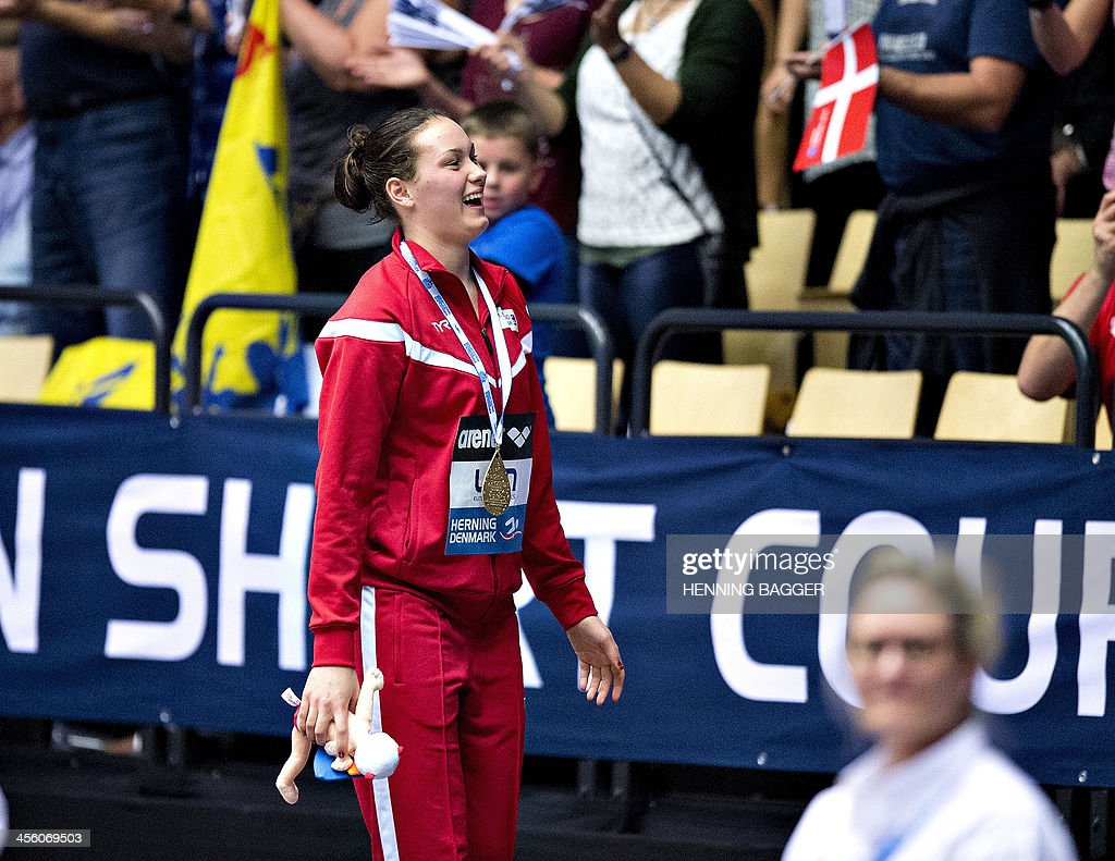 Denmark's <a gi-track='captionPersonalityLinkClicked' href=/galleries/search?phrase=Mie+Nielsen&family=editorial&specificpeople=3000359 ng-click='$event.stopPropagation()'>Mie Nielsen</a> celebrates her gold medal after the 100m breaststroke event of the Len European Short Course Swimming Championships in Herning, Denmark, December 13, 2013.