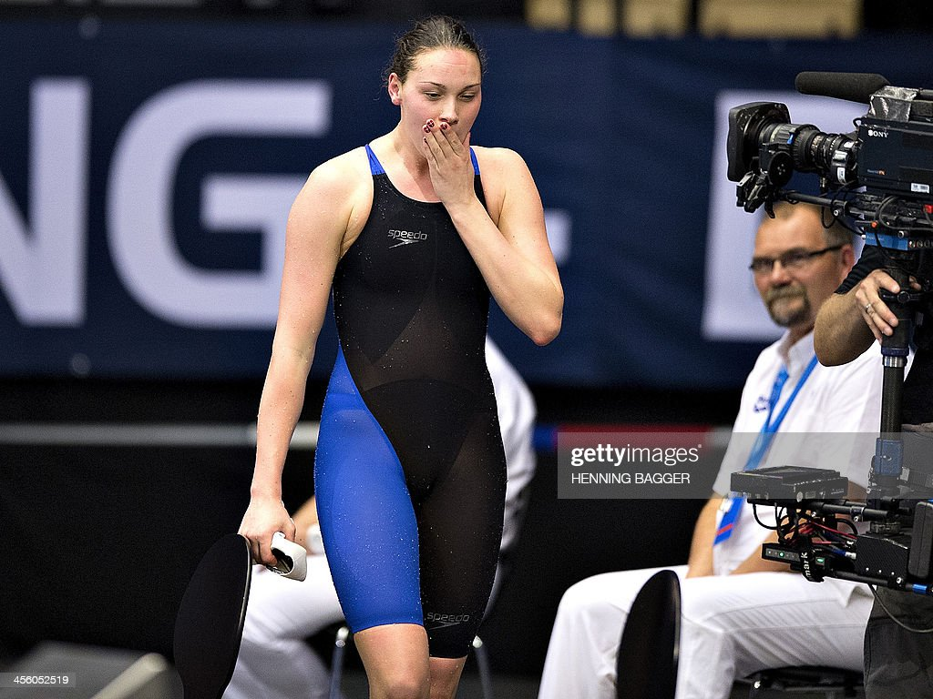 Denmark's <a gi-track='captionPersonalityLinkClicked' href=/galleries/search?phrase=Mie+Nielsen&family=editorial&specificpeople=3000359 ng-click='$event.stopPropagation()'>Mie Nielsen</a> reacts after winning the 100m breaststroke event of the Len European Short Course Swimming Championships in Herning, Denmark, December 13, 2013.