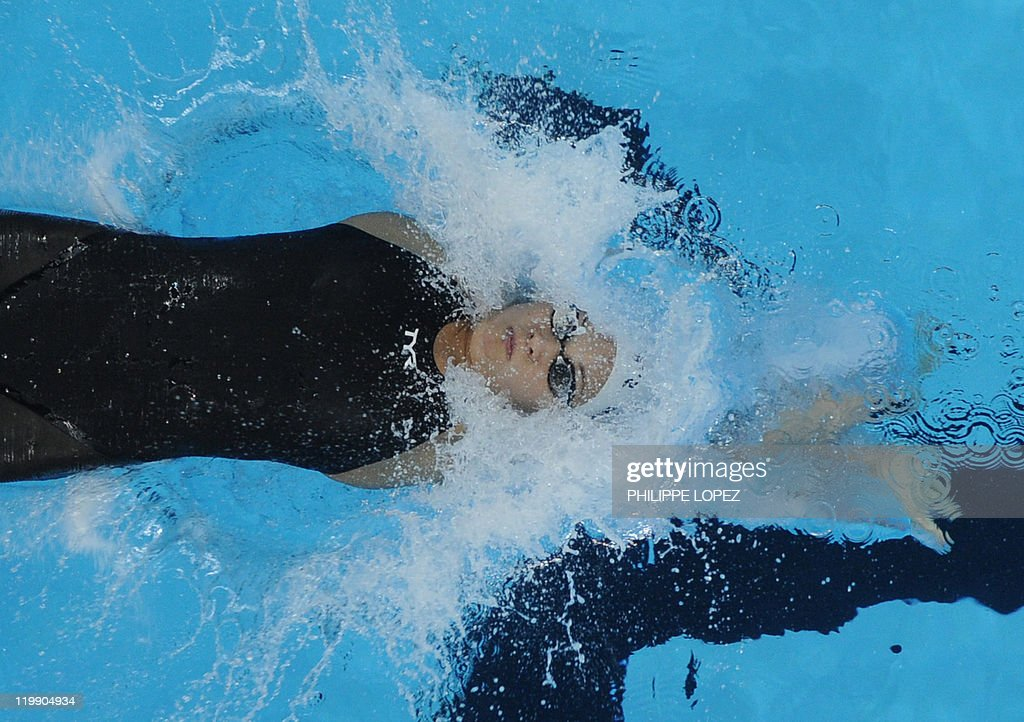 Denmark's Mie Nielson competes in the heats of the women's 50-metre backstroke swimming event in the FINA World Championships at the indoor stadium of the Oriental Sports Center in Shanghai on July 27, 2011.