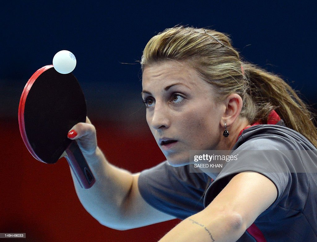 Denmark's Mie Skov serves against Poland's Natalia Partyka during a table tennis women's singles preliminary round match of the London 2012 Olympic Games at the Excel centre in London July 28, 2012. AFP Photo / Saeed Khan