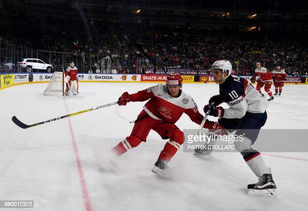 Denmark´s Morten Green and US Anders Bjork vie for the puck during IIHF Ice hockey world championship first round match between USA and Denmark in...