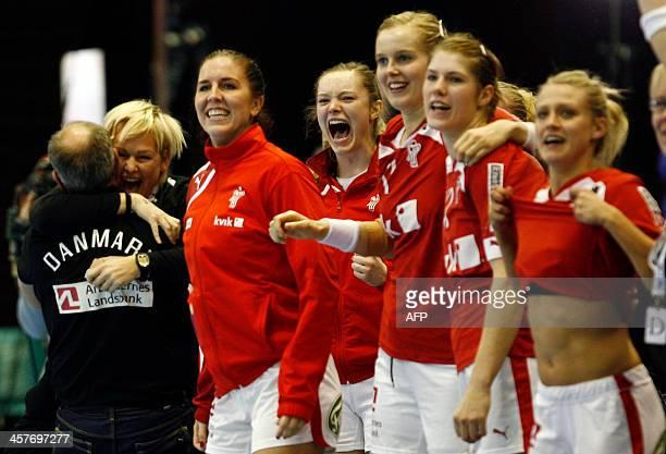 Denmark's national handball team players celebrate victory in Women's Handball World Championship 2013 quarter final match against Germany on...