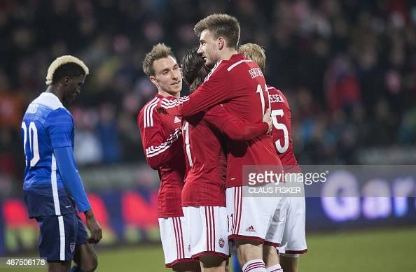 Denmark's Nicklas Bendtner celebrates with teammates after scoring during the friendly football match Denmark vs USA in Aarhus Denmark on March 25...
