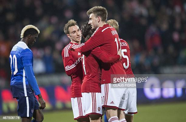 Denmark's Nicklas Bendtner celebrates with teammates after scoring during the friendly football match Denmark vs USA in Aarhus Denmark on March 25...