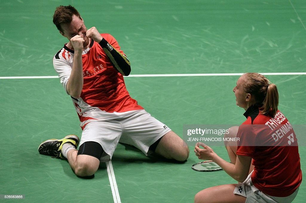 Denmark's Niclas Nohr (L) and teammate Sara Thygesen celebrate after winning against Denmark's players Mathias Christiansen and Lena Grebak during the 2016 European Badminton Championships mix double semi-final match between Denmark and Denmark, on April 30, 2016 in Mouilleron-le-Captif, western France. / AFP / JEAN