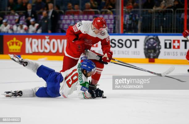 Denmark´s Nikolaj Ehlers and Italy´s Raphael Andergassen vie during the IIHF Men's World Championship ice hockey match between Denmark and Italy in...
