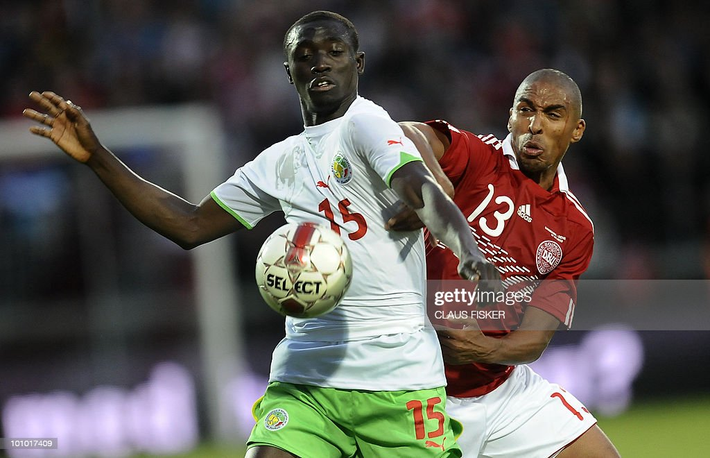 Denmarks Patrick Mtiliga (R) vies for the with Demba Cisse (L) of Senegal during their friendly football match May 27, 2010, in Aalborg, northern Denmark.AFP PHOTO /Scanpix/ CLAUS