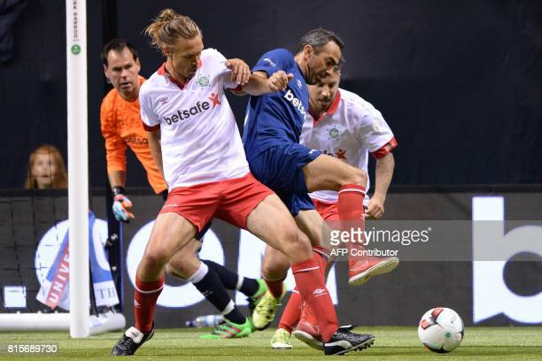 Denmark's Per Kroldrup vies with France's Youri Djorkaeff during the Star Sixes final football match between France and Denmark at the O2 Arena in...