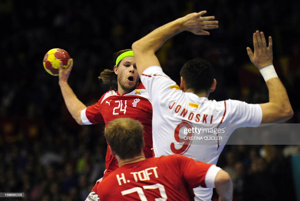 Denmark's pivot Henrik Toft (L) vies with Macedonia's back Ace Jonovski (R) during the 23rd Men's Handball World Championships preliminary round Group B match Denmark vs Macedonia at the Palacio de Deportes San Pablo in Sevilla on January 18, 2013.