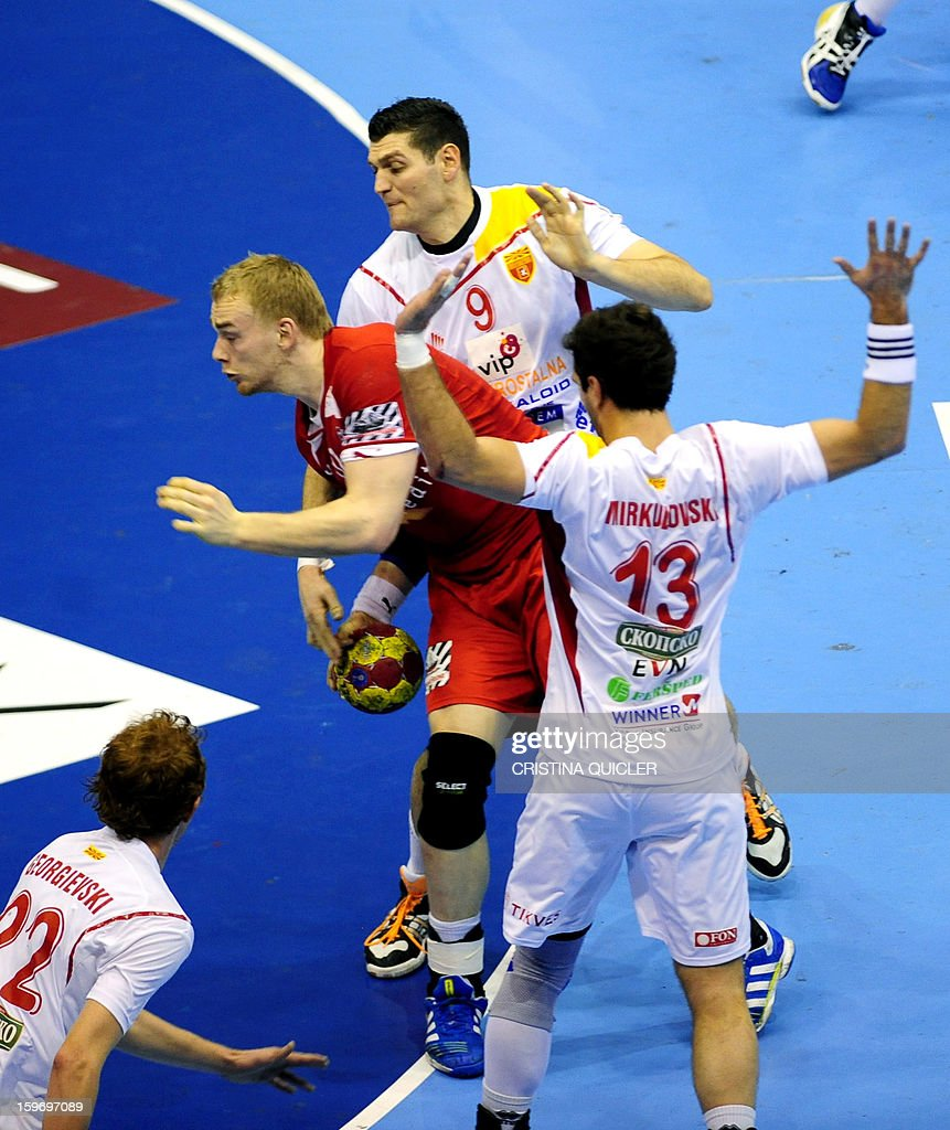 Denmark's pivot Rene Toft (L) vies with Macedonia's back Ace Jonovski (R) during the 23rd Men's Handball World Championships preliminary round Group B match Denmark vs Macedonia at the Palacio de Deportes San Pablo in Sevilla on January 18, 2013.AFP PHOTO/ CRISTINA QUICLER