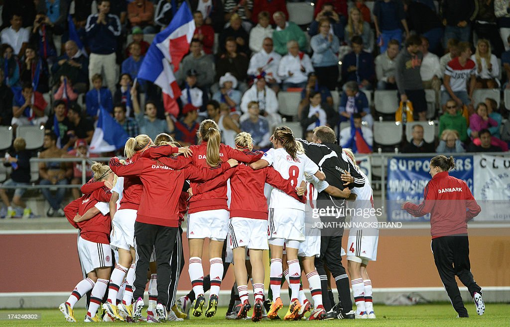 Denmark's players celebrate after winning in the penalty shootout the UEFA Women's European Championship Euro 2013 quarter final football match France vs Denmark on July 22, 2013 in Linkoping, Sweden.