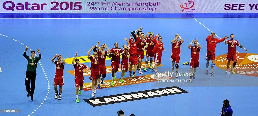 Denmark's players celebrate after winning the 23rd Men's Handball World Championships preliminary round Group B match Denmark vs Macedonia at the Palacio de Deportes San Pablo in Sevilla on January 18, 2013. Denmark won 33-30.