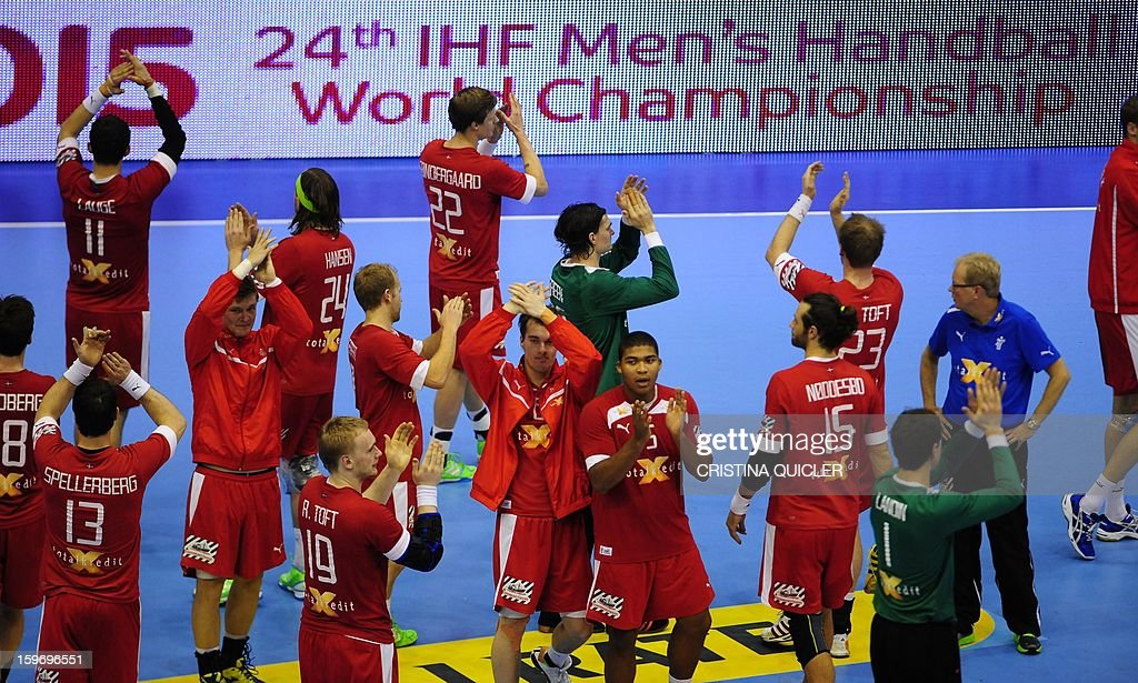 Denmark's players celebrate after winning the 23rd Men's Handball World Championships preliminary round Group B match Denmark vs Macedonia at the Palacio de Deportes San Pablo in Sevilla on January 18, 2013. Denmark won 33-30.