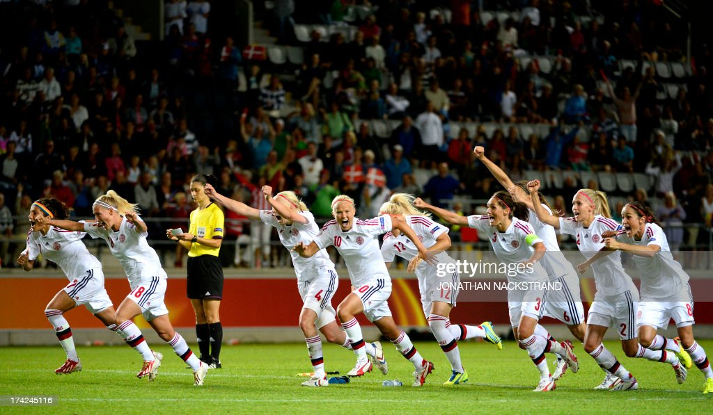 Denmark's players celebrates theit victory as teammate Janni Arnth scores the last point in the penalty shootout of the the UEFA Women's European Championship Euro 2013 quarter final football match France vs Denmark on July 22, 2013 in Linkoping, Sweden.